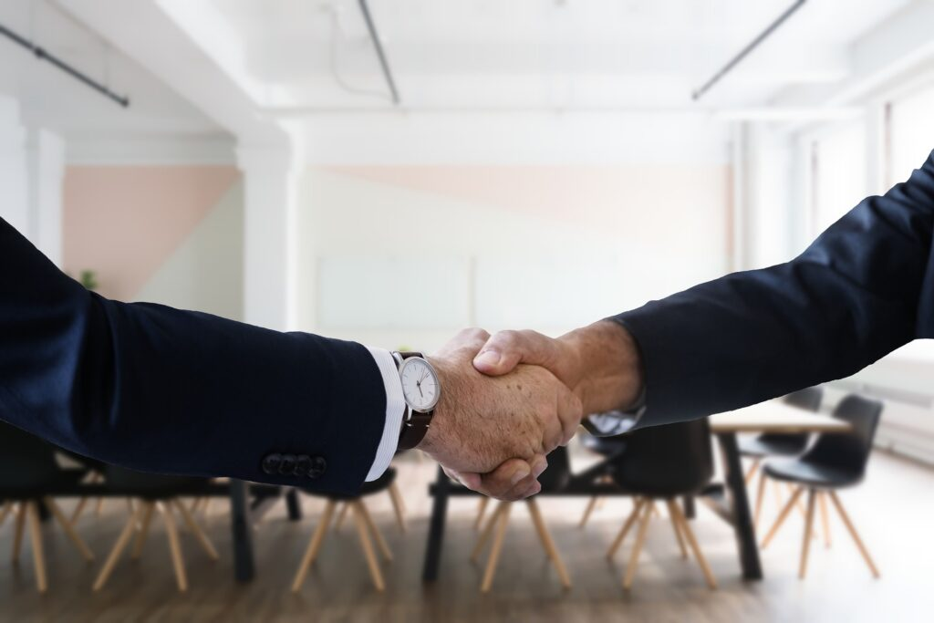 Handshake showing success in hiring and retaining the right employees at dealership